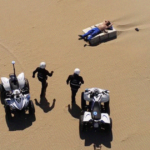 Aerial Photo Of Officers And A Quarantine-Breaking Man On The Beach Looks Like An Album Cover, People Start Photoshopping It